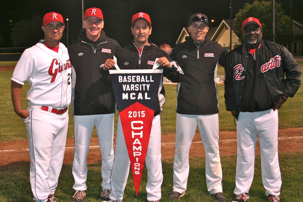 The Redwood Coaching Staff proudly hold the MCAL Banner after the game.  From left to right, Joel Russo, Rich Ependio, Head Coach Mike Firenzi, Freshman Coach Taber Watson, and Tim Grayson